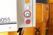 「結束ボタン」が点灯すると、梱包物が最大サイズになったサイン